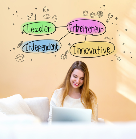 Entrepreneur theme with young woman using her laptop computer at home