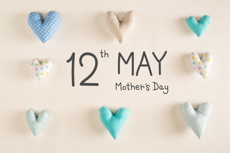 Mothers Day message with blue heart cushions on a white paper background Stock Photo - 121583422