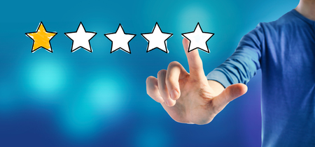 One star rating with a man on a blue background Imagens