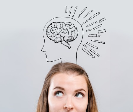 Brain illustration with young woman looking upwards