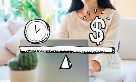 Time and money on the scale with woman using her laptop in her home office