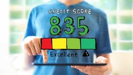 Excellent credit score theme with young man using a tablet computer Stock Photo
