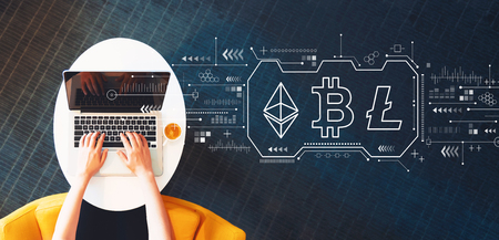 Cryptocurrency - Bitcoin, Ethereum, Litecoin with person using a laptop on a white table