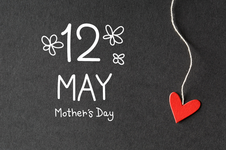 12 May Mothers Day message with handmade small paper hearts Stock Photo