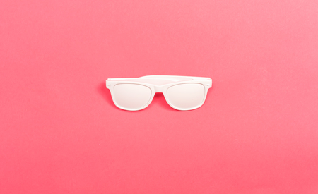 Funky party opaque glasses on a pink paper background Фото со стока - 122027269