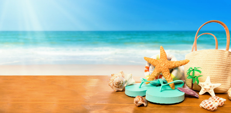 Flip flops with starfish on the tropical beach Stock Photo