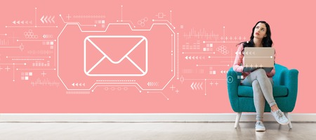 Email with young woman using a laptop computer