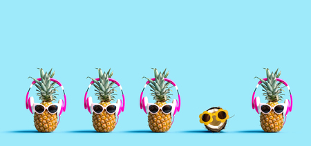 One out unique coconut wearing sunglasses with many pineapples wearing headphones