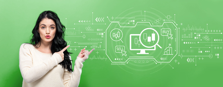 Stock trading concept with young woman pointing on a green background