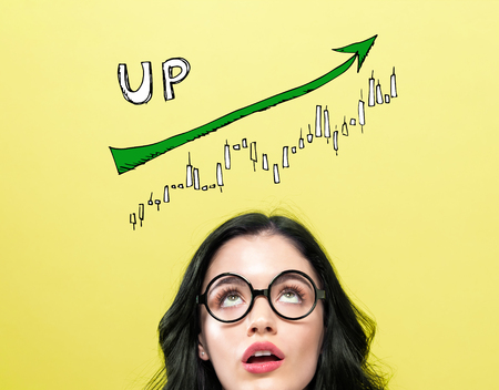 Market up trend chart with young woman wearing eye glasses