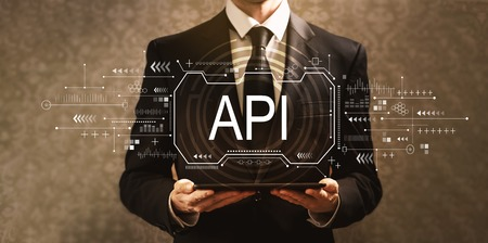 API concept with businessman holding a tablet computer