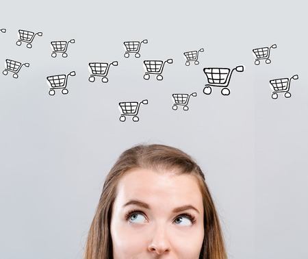 Online shopping with young woman looking upwards