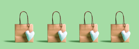 Many shopping bags with small heart cushions Stok Fotoğraf