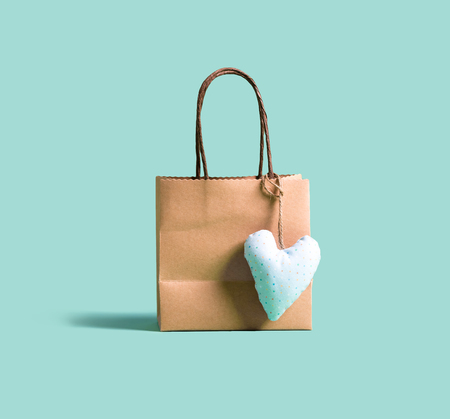 A shopping bag with small heart cushion