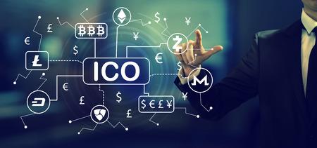 Cryptocurrency ICO theme with a businessman in an office Zdjęcie Seryjne
