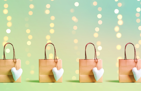 Shopping bags on a shiny light background