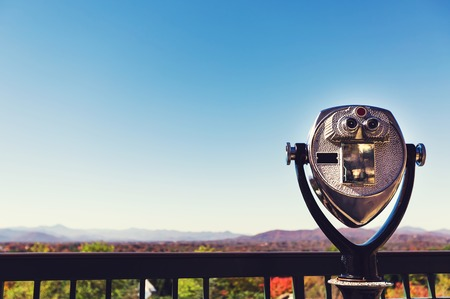 Coin-operated binoculars looking out over an autumn landscape Banco de Imagens