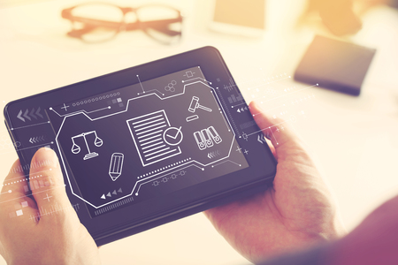 Compliance theme with man holding a tablet computer