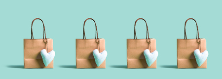 Many shopping bags with small heart cushions Stock Photo
