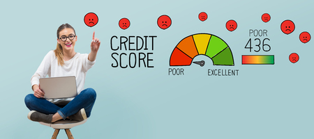 Poor credit score theme with young woman using her laptop 스톡 콘텐츠