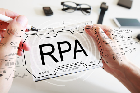 Robotic process automation concept with man writing in a notebook 스톡 콘텐츠