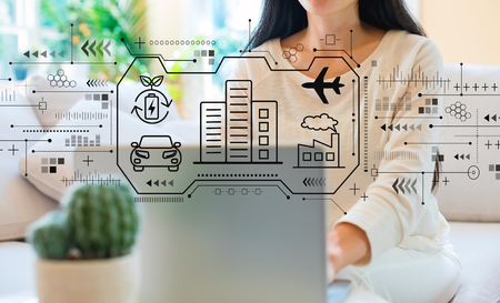 Smart city concept with woman using her laptop in her home office