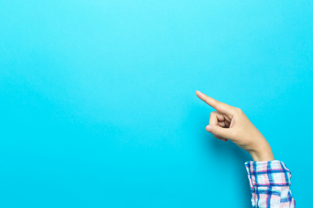 Person pointing at something on a blue background