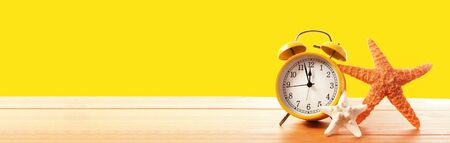 Clock showing nearly 12 on a yellow background