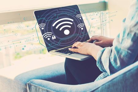 Wifi with woman using her laptop in her home office Фото со стока - 124463318