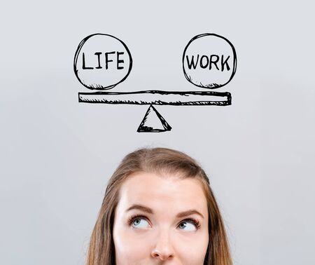 Life and work balance with young woman looking upwards