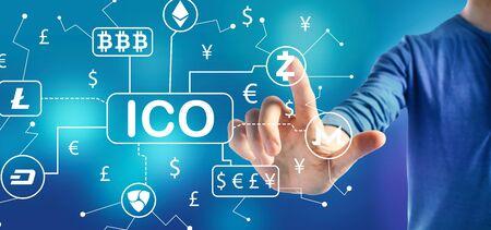 Cryptocurrency ICO theme with a man on a blue background Zdjęcie Seryjne