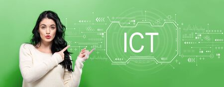 Information and communications technology with young woman pointing on a green background
