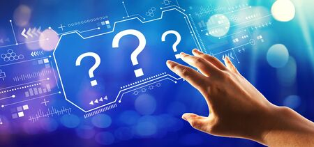 Question marks with hand pressing a button on a technology screen Stock Photo