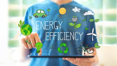 Energy efficiency with young man using a tablet computer 写真素材 - 124669006