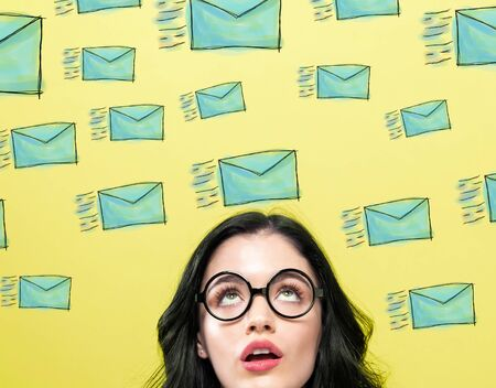 Many sketch emails with young woman wearing eye glasses