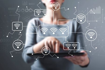 Wifi theme with business woman using a tablet computer Imagens - 124669051