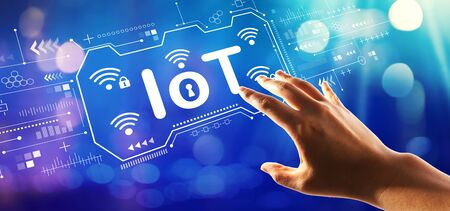 IoT theme with hand pressing a button on a technology screen Imagens - 124669055