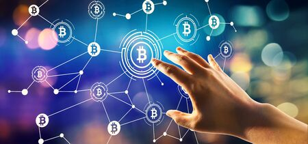 Bitcoin theme with hand pressing a button on a technology screen Imagens - 124669105