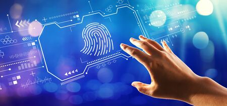 Fingerprint scanning theme with hand pressing a button on a technology screen Imagens - 124669106