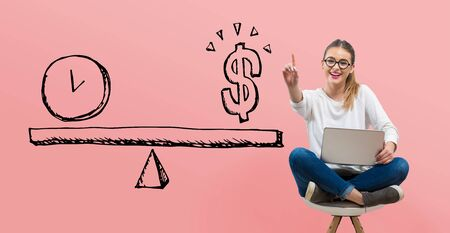 Time and money on the scale with young woman using her laptop