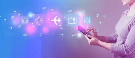 Airplane travel theme with business woman using a tablet computer Imagens - 124669137