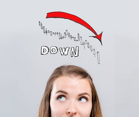 Market down trend chart with young woman looking upwards
