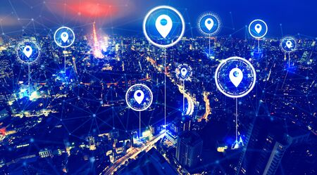 Map pins with aerial view of Tokyo, Japan at night 写真素材
