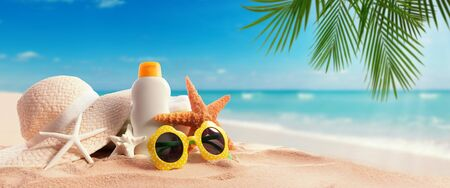 Sunblock Bottle on the tropical beach and sunshine Stock Photo