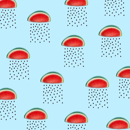 Watermelons and seeds rain concept on a blue background