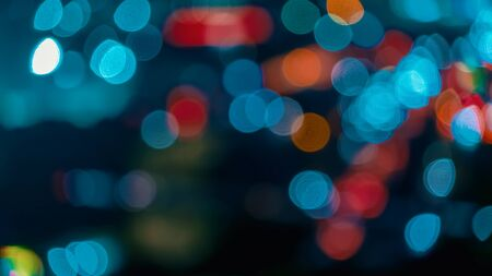 Blurred abstract bokeh background of city lights at night