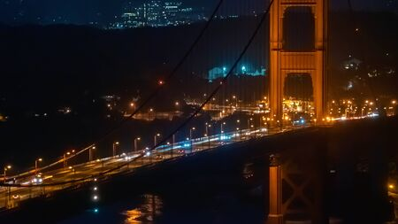 Traffic passes over San Franciscos Golden Gate Bridge Stock Photo