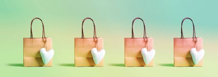Many shopping bags with small heart cushions Banco de Imagens