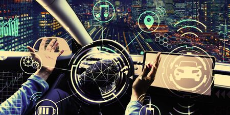 Person using a car in autopilot mode hands free Фото со стока