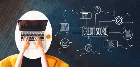 Credit score theme with person using a laptop on a white table Stock Photo